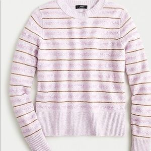 Supersoft crew neck sweater with metallic stripe.